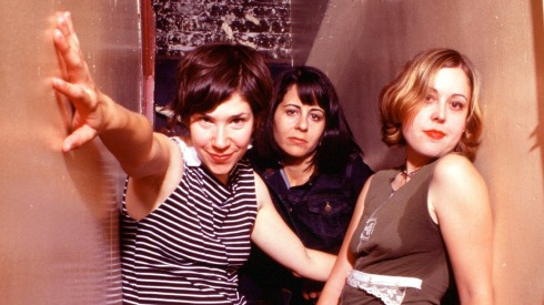Portrait of Sleater-Kinney (L-R) Carrie Brownstein, Janet Weiss, Corin Tucker, backstage at The Fillmore in San Francisco, California, USA on 23rd September 2002. (Photo by Anthony Pidgeon/Redferns)